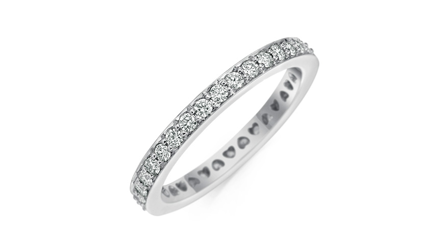 Gumuchian platinum band with diamonds and heart motif ajour