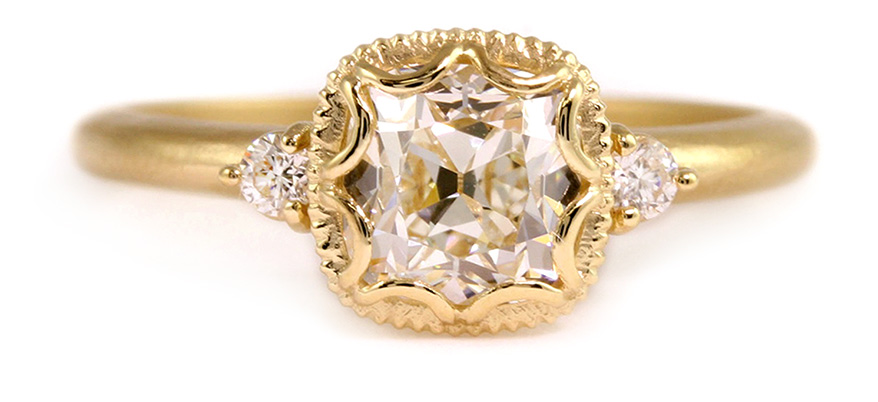 Megan Thorne 18K yellow gold ring with cushion cut center diamond
