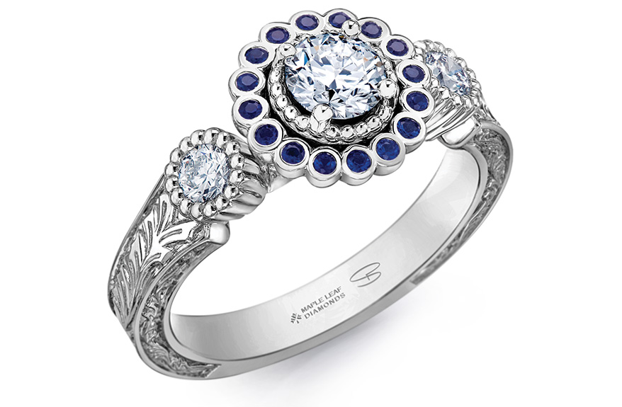 Shelly Purdy 18K gold/palladium ring with round-cut center diamond, sapphire halo, and diamonds