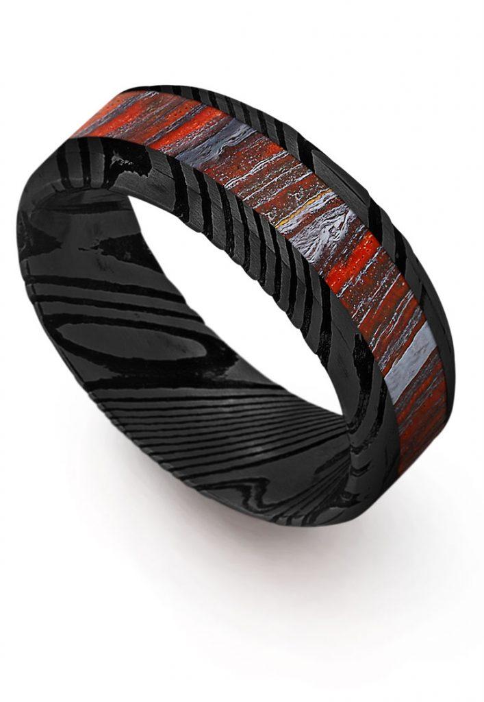 Thorsten Beveled black damascus steel wedding band with Tiger Iron inlay