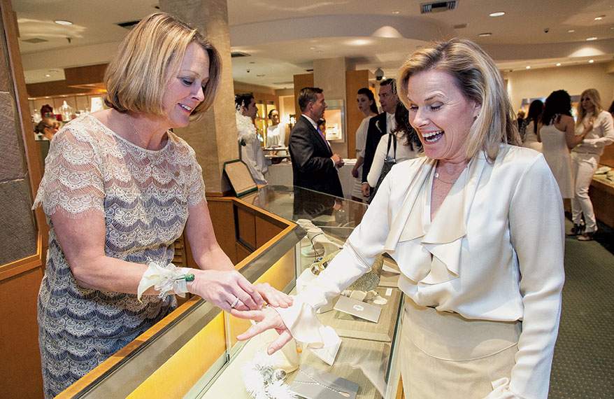 Two ladies in a jewelry shop.