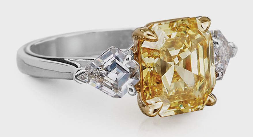 GN Diamond platinum ring with 18K yellow gold and fancy yellow diamond (4.20 TCW)
