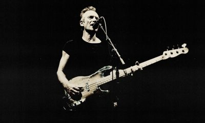 Sting playing bass guitar and singing.
