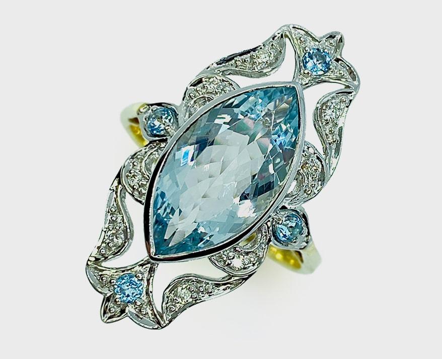 Melinda Lawton's 14K white and yellow gold ring with aquamarine, diamonds and blue topaz