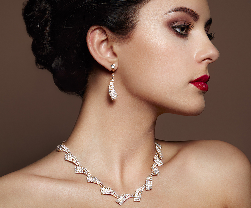 lady in photoshoot wearing earrings and necklace