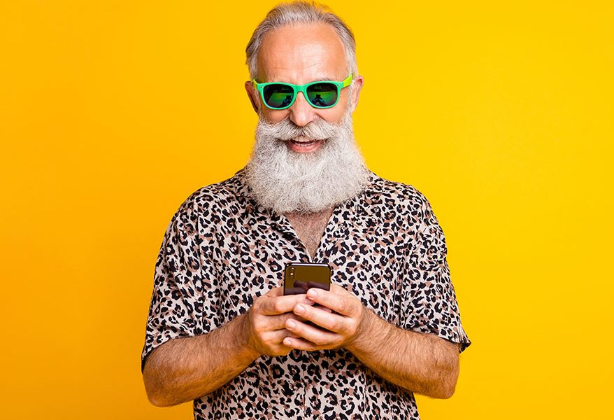 man wearing sunglasses holding phone