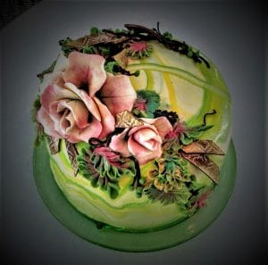 John Buzogany cake decorated with flowers