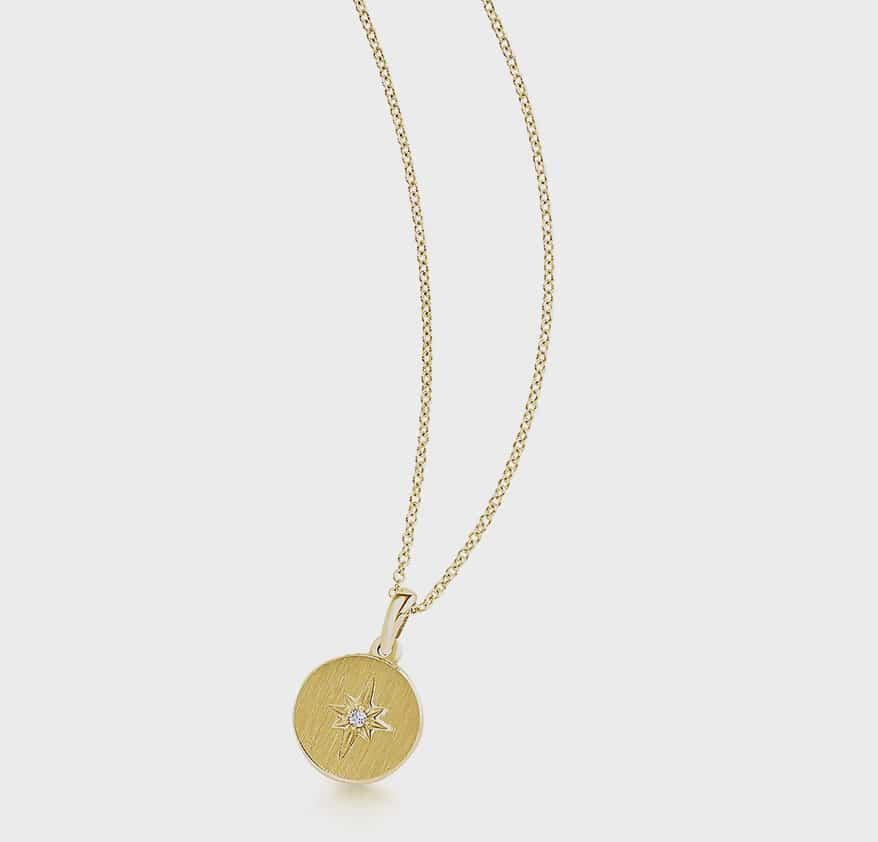 302 Fine Jewelry 14K yellow gold necklace with diamond.