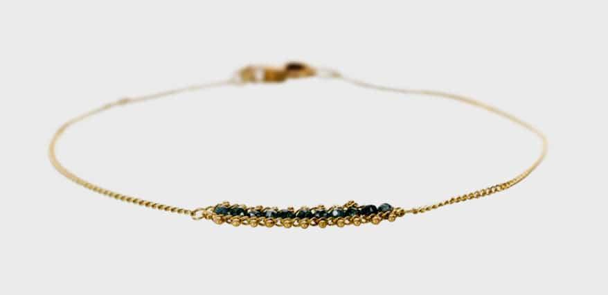 Amali Jewelry  18K gold textile bracelet with a station of blue diamonds.