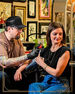 Jack Lewis Jewelers Sales associate Holly Stief getting tattoo