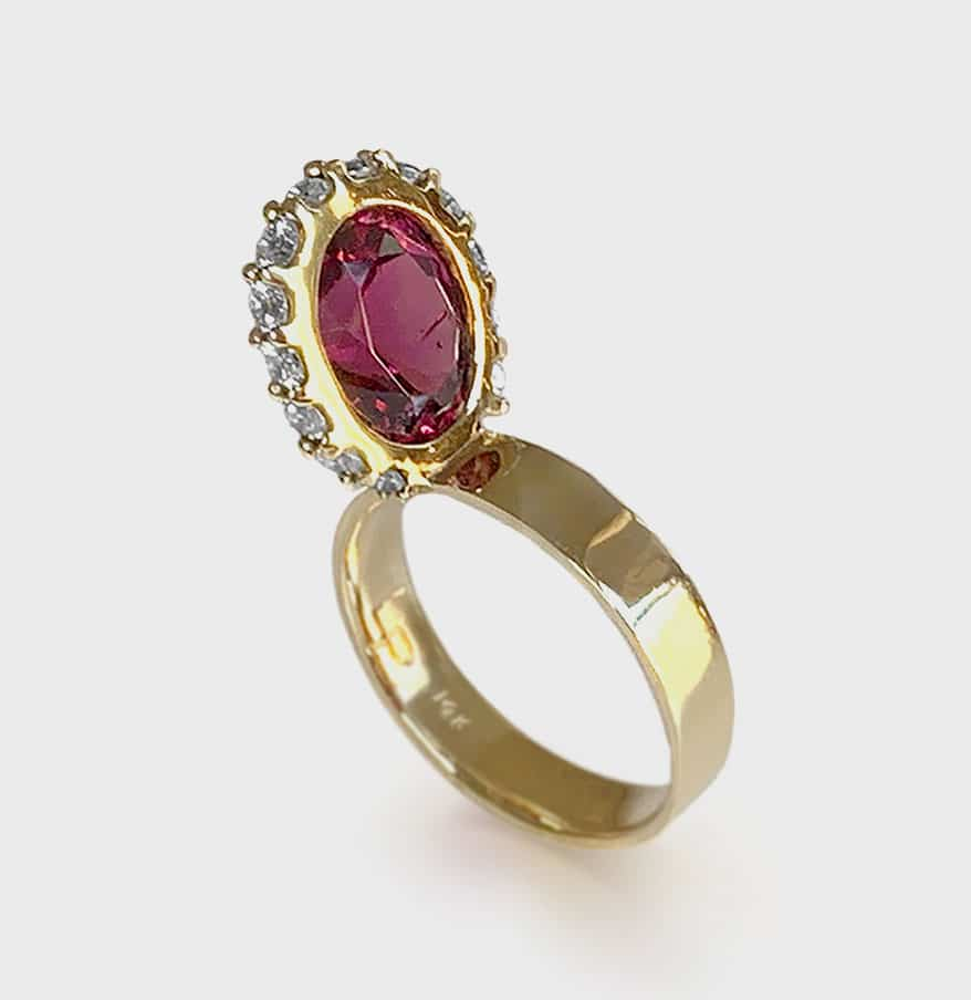 Leslie Paige 14K yellow gold ring with rhodolite garnet (3.62 TCW) and diamonds.