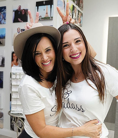 Christina Baribault-Ortiz and her cousin Victoria Baribault celebrate the collection's debut