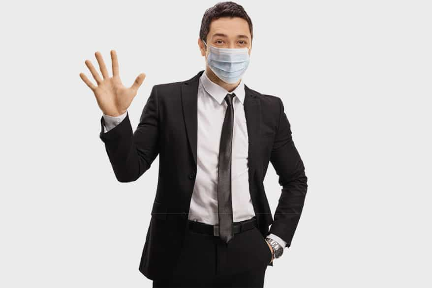 man with mask wave hand