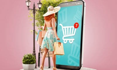 woman infront of mobile phone shopping