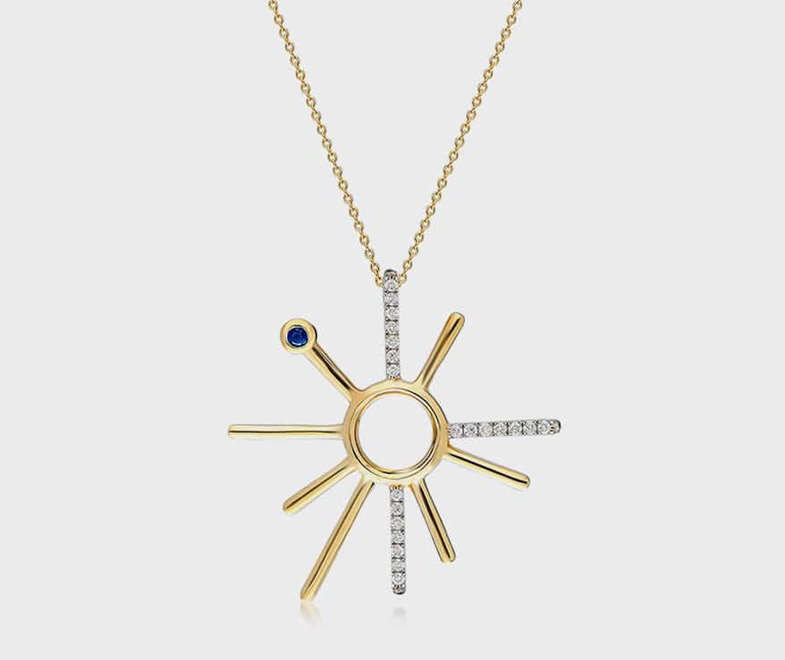 İTÄ 14K yellow gold necklace with diamonds and sapphire.
