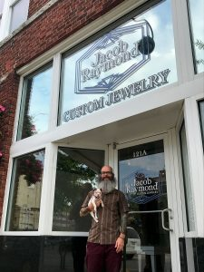 Jacob Raymond Custom Jewelry owner outside building