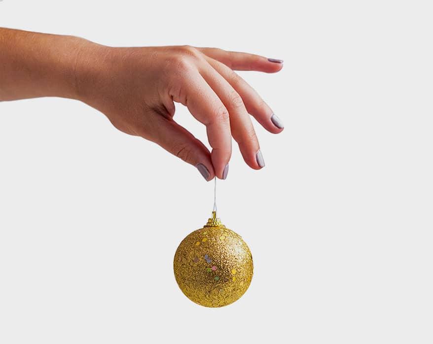 Hand holding Christmas ball