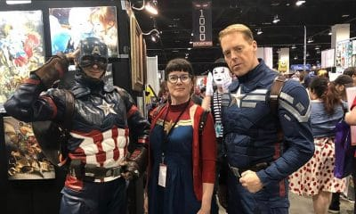 Jamie Hollier, center, is Captain Marvel at Denver's comic convention.