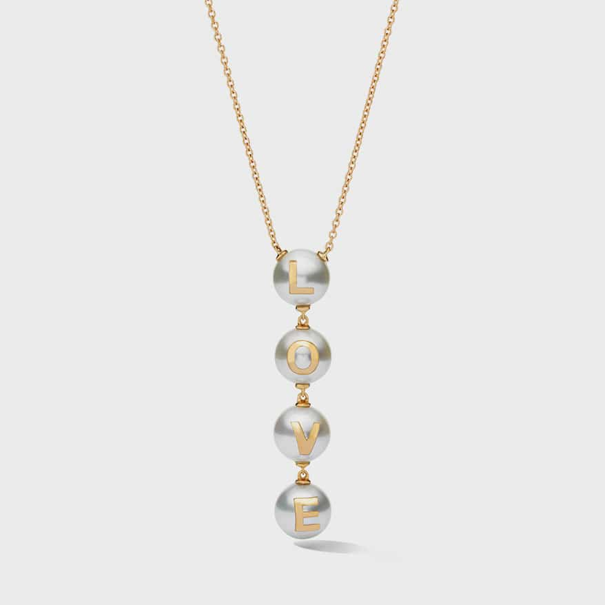 W. Rosado Love pendant featuring Australian South Sea pearls embedded with 18K gold and pavé letters.