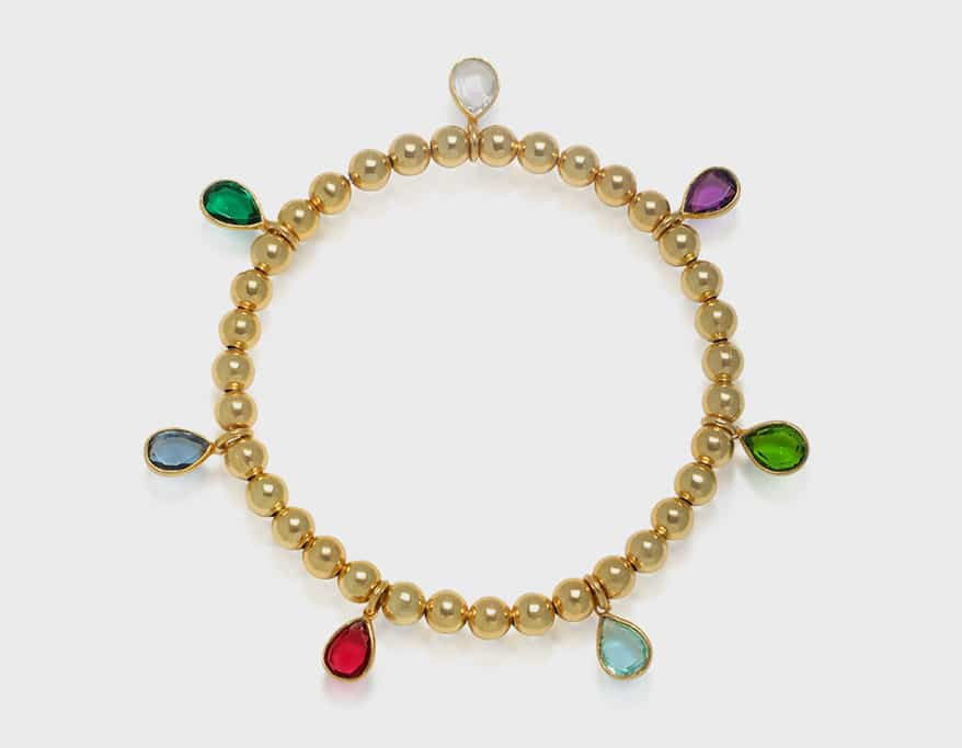 Amelia Rose Design Bracelet with gold-plated beads and colorful quartz teardrops on elastic cord.