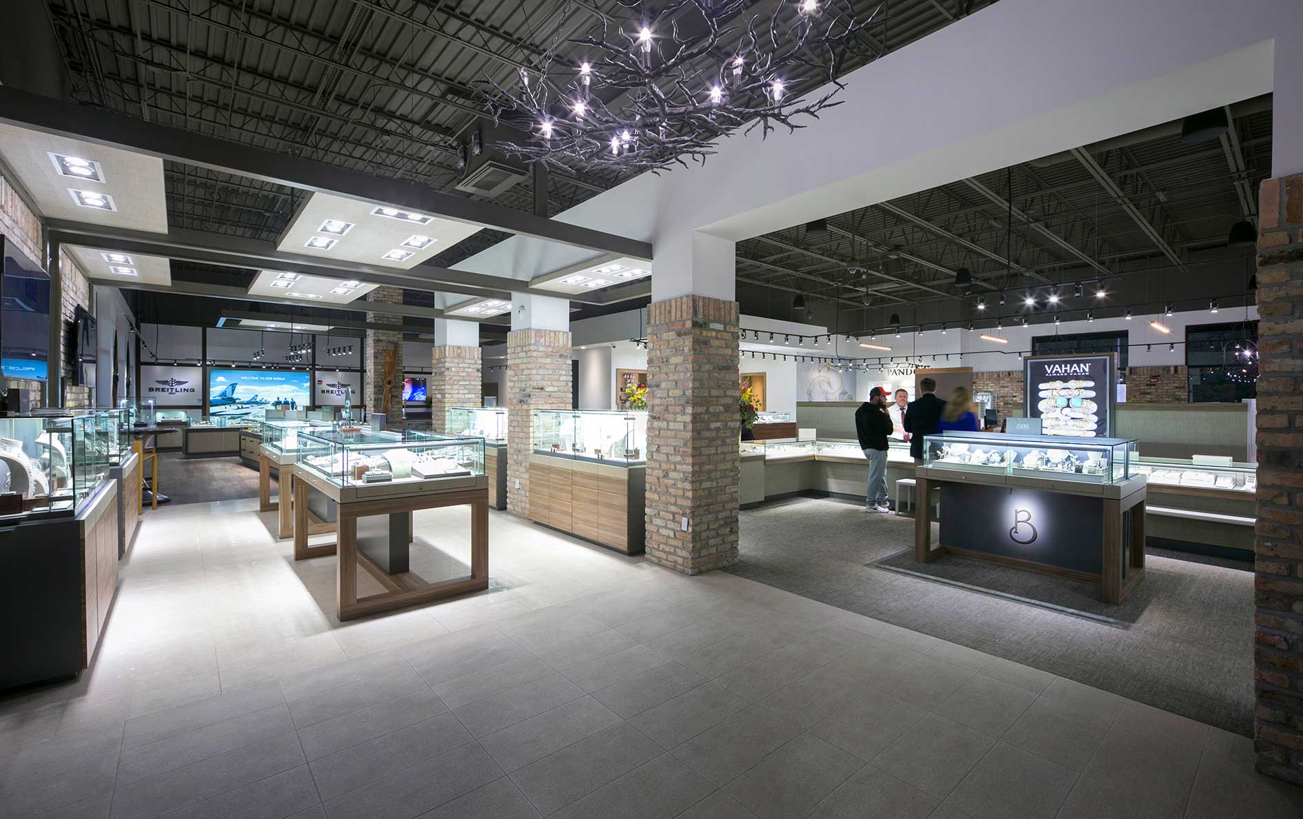 An openfloorplan and varied materials create a modern look at Beré Jewelers in Pensacola