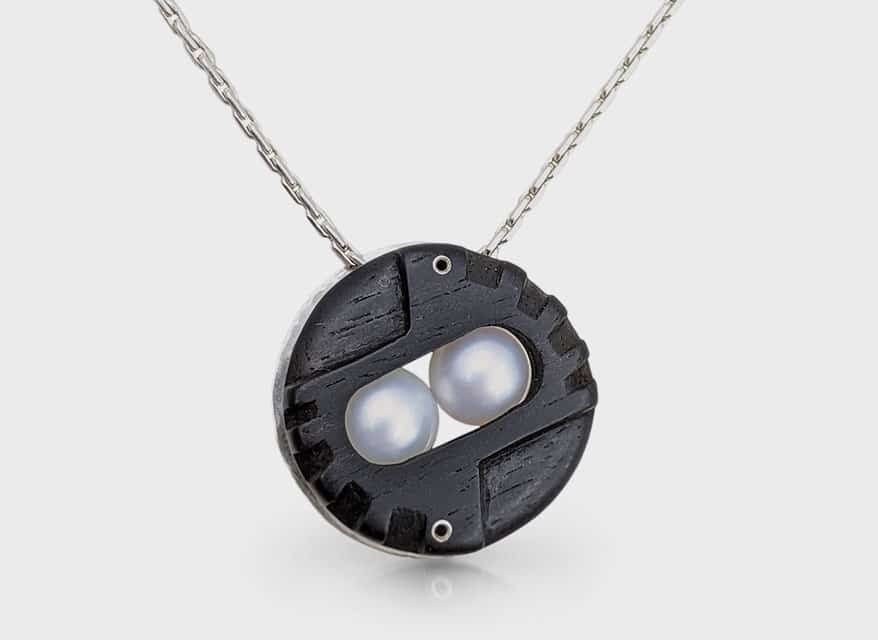 Lola Zyscovich Silver necklace with hand-carved ebony and pearls.