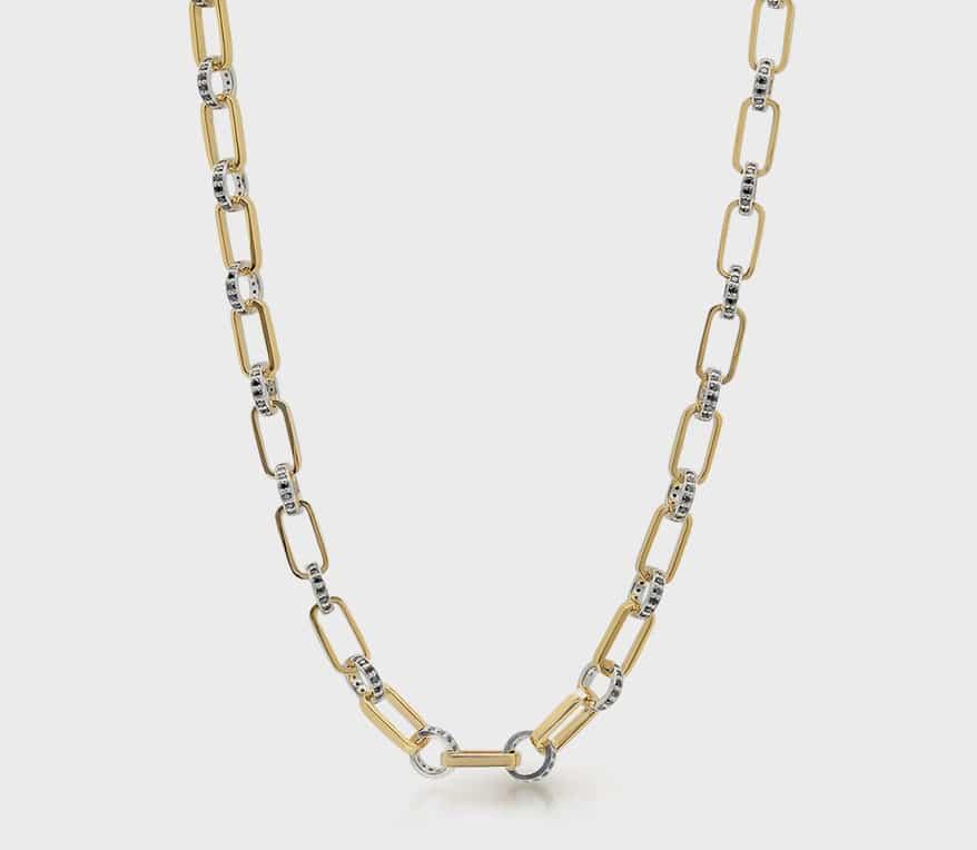 Nancy Newberg 14K gold oval necklace with silver links and black diamonds.