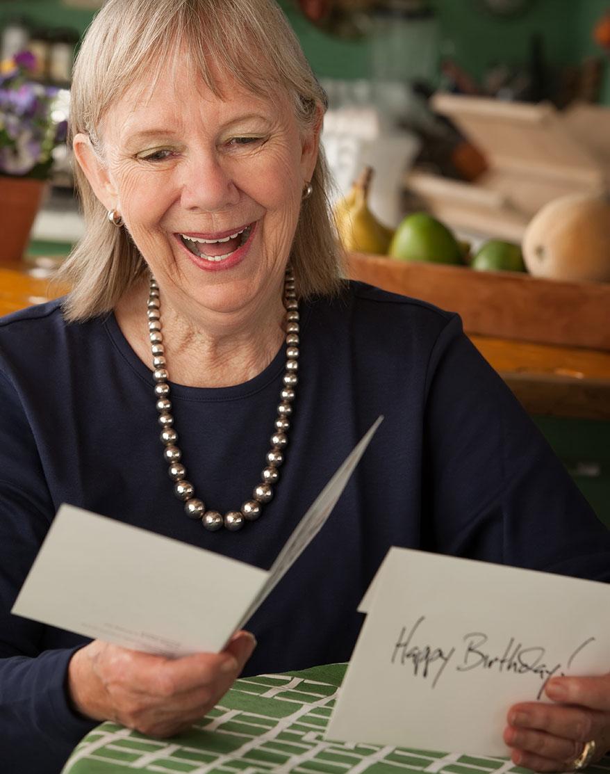 old lady reading birthday card