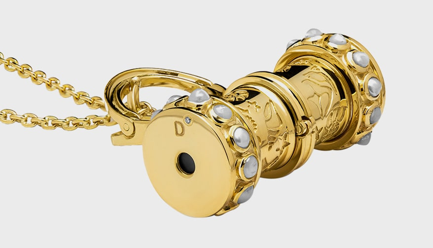 Drutis 18K yellow gold pendant with pearl, Swiss topaz, tanzanite, emerald and apatite.