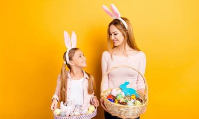 girl and woman holding easter baskets