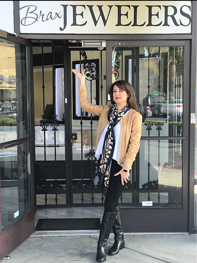 Amy Astaraee poses outside of her Newport Beach store.