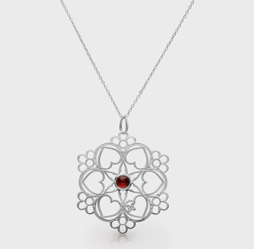 Tanya Moss Jewelry  Sterling silver pendant with garnet.