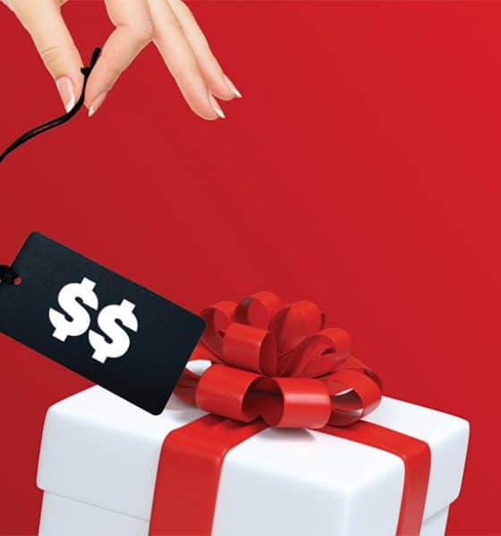 hand holds price tag for gift