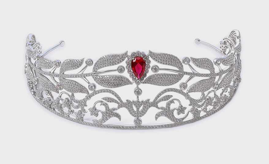 "Sterling silver tiara with ""diamond crystalline"" simulant stones."
