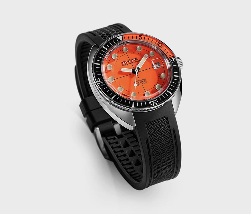 Watch with black sport rubber strap, stainless steel case, and self-winding mechanism.