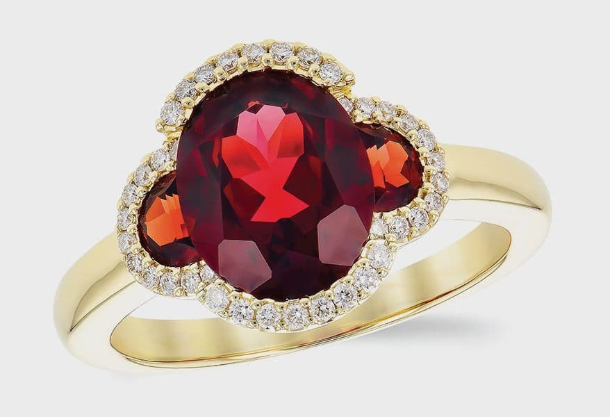 14K yellow gold ring featuring garnets with diamonds