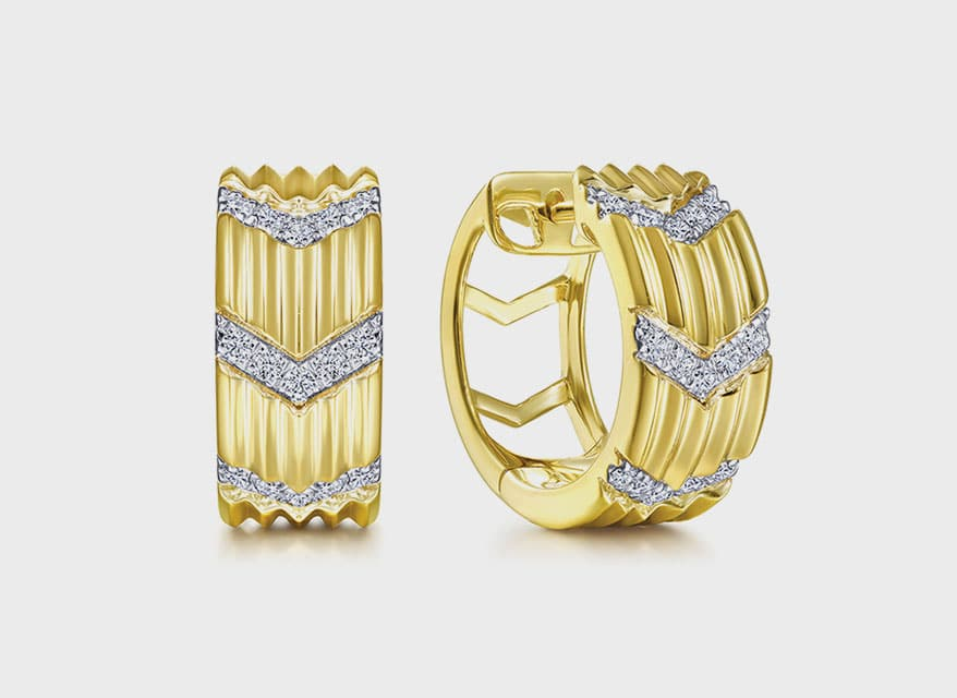 Gabriel & Co 14K yellow gold huggie earrings with diamonds.