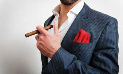 man-holding-cigar
