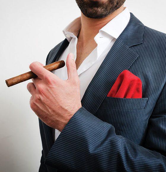 man-holding-cigar