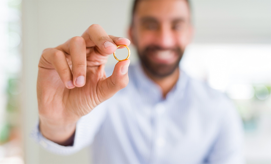 man hold wedding ring