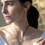 model wearing pieces from Monica Rich Kosann's enameled vermeil Zodiac collection.