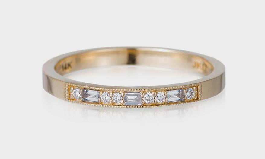 Jennie Kwon Designs 14K yellow gold band with diamonds.