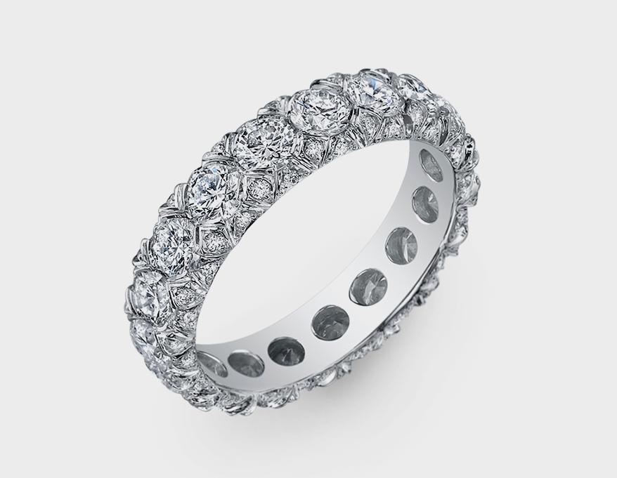 Pompos Jewelry Platinum band with diamonds