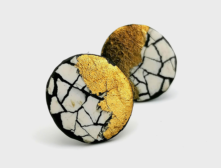 Sterling silver earrings with gold leaf and Urushi lacquer.