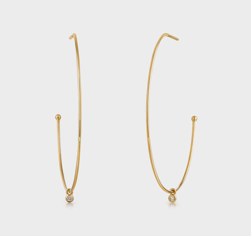 Aurelie Gi 14K yellow gold earrings with diamonds.