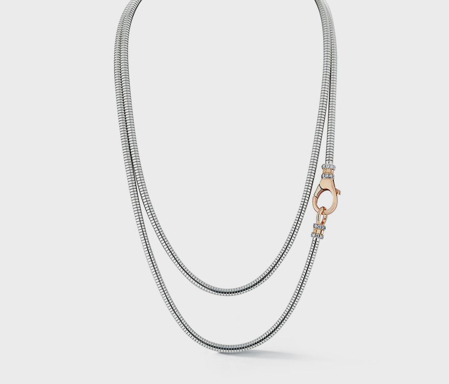 Walters Faith 18K rose gold, sterling silver, and diamond necklace.