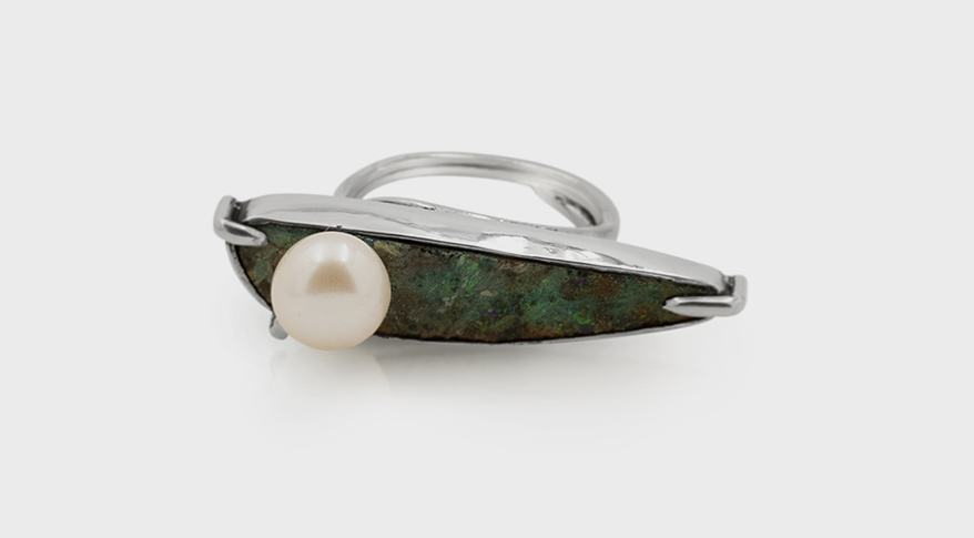 Angely Martinez Silver ring with boulder opal, pearl, and resin.