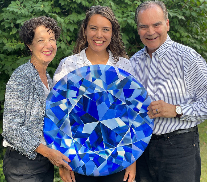 Ginger Rachel and Roger Dery hold Tanazanite painting by Reena Ahluwalia.
