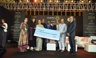 Udayan Care representatives receiving a cheque o Rs. 25 lakh from Jewellers For Hope