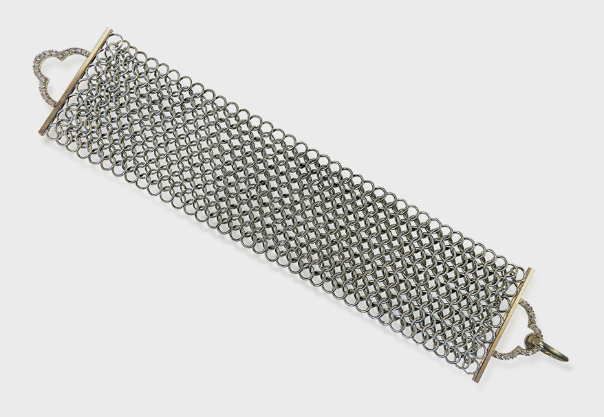 Alison Nagasue  Japanese sterling silver chainmail bracelet with 14K yellow gold and diamonds.